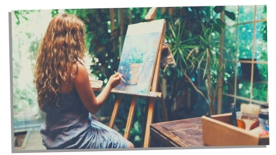 Woman practising self care by painting