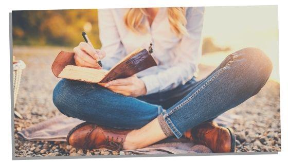 woman journaling for manifestation