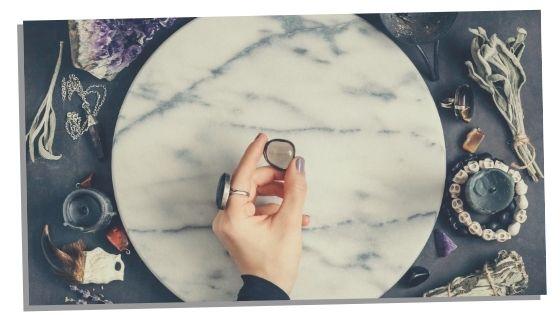 Woman choosing her chakra balancing crystal