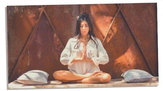 Woman sitting crossed legged to balance root chakra