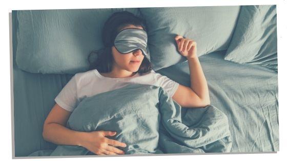 Woman sleeping peacefully with balanced root chakra