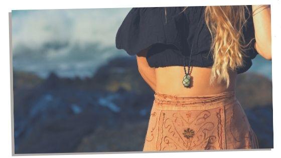 Woman wearing crystal to help balance heart chakra