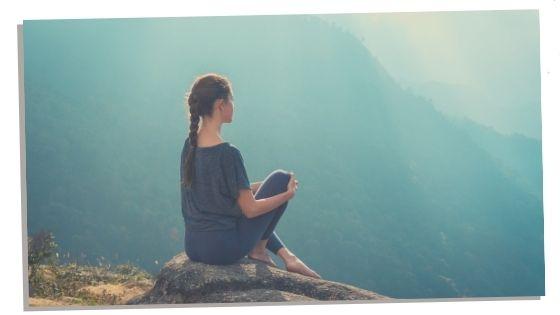 Sigma female sitting in peace on rock