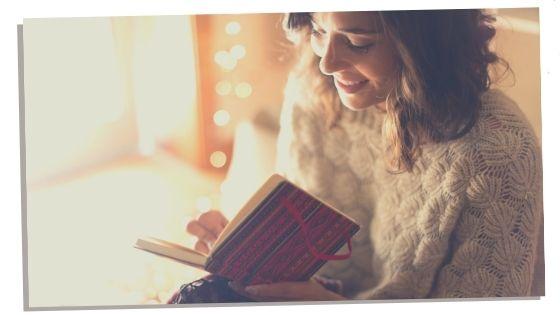 Woman writing in self love journal