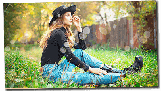 Feminine woman sitting on grass