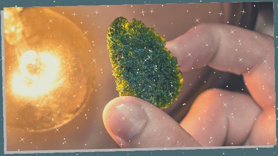 Moldavite being held for good luck