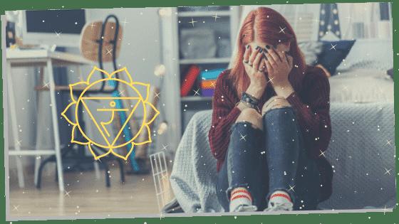 a woman sitting down experiencing a blocked solar plexus chakra sign