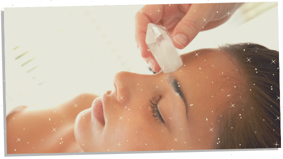 A crystal healing being combined with Reiki