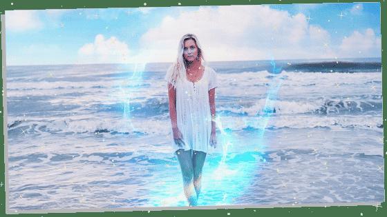 woman on beach with a sky blue aura